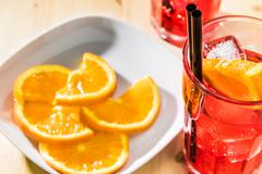 Close-up of glass of spritz aperitif aperol cocktail with orange slices and i Stock Photos