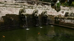 Ancient angel sculptures with waterspouts, falling stream, stone bathing pool Stock Footage