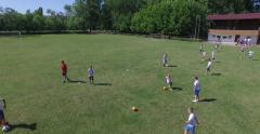Training at football school, 4k (Aerial) Stock Footage