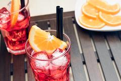 Glasses of spritz aperitif aperol cocktail with orange slices and ice cubes Stock Photos