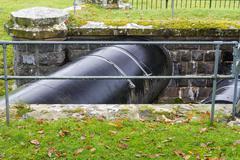 Huge Black Pipe transporting water United Kingdom. Stock Photos