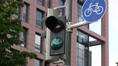 Signal light for cyclists changing from green to red Stock Footage