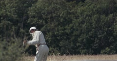 Anonymous Old Man Golf Swing 4K - Mid Shot Stock Footage