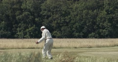 Stock Video Footage of Anonymous Old Man Golf Swing 4K - Wide