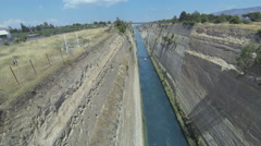 View from a bridge down to Corinth Canal with a passing boat Stock Footage