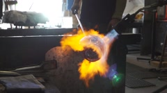 Glass blowtorch shaping and sun Stock Footage