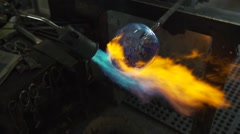 Glass and blowtorch shaping tight Stock Footage