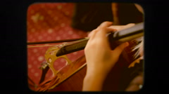 Musician Playing the Violoncello. Retro Stock Footage