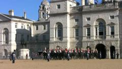 The Household Cavalry riding across Horse Guards Parade in London Stock Footage