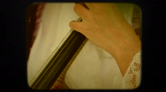 Woman Playing the Violoncello. Retro Stock Footage