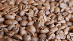 High quality Arabica type coffee beans on table slow dolly shoot moving 4K  - stock footage