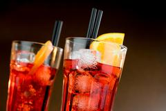 two glasses of spritz aperitif aperol cocktail with orange slices and ice cub - stock photo