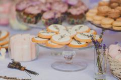 Dessert table for a wedding party. Biscuits decorated with lavanda flowers - stock photo