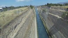 View from a bridge down to Corinth Canal with a passing boat coming closer Stock Footage