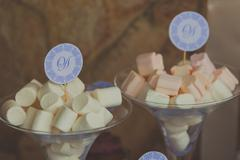 Two glasses of marshmallow sticks at the sweet bar on wedding Stock Photos