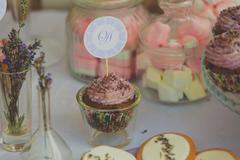 Closeup of cupcakes with lavanda flowers at wedding party Stock Photos