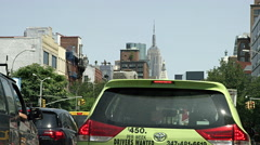 Green taxi cab Houston Street traffic Empire State Building NYC 4K Stock Footage