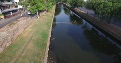 Forward dolly along old city canal Stock Footage