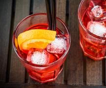 spritz aperitif aperol cocktail with orange slices and ice cubes - stock photo