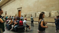 Unidentified tourists at one of the halls of British Museum. Parthenon marbles Stock Footage