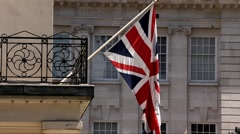 English flag on the balcony of a building Stock Footage