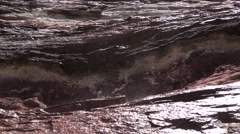 Water drops falling on porphyry sedimentary rocks in the Canyon - stock footage