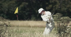 Stock Video Footage of Old Man Playing Golf - Swing Club - 4K