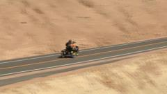 Motorcycle Racing up Mountain Road Stock Footage