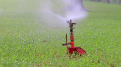 water sprinkler in green field - stock footage