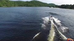 Aerial shot of tubing and boat on the lake Stock Footage