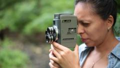 Woman Filming With Vintage Film Camera in Forest Stock Video Stock Footage