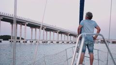 Man standing in sailboat Stock Footage