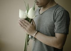 Young man in handcuffs and lotus in hand Stock Photos