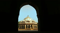 Female visitor walks under arch at Humayun's, tomb of Isa Khan Niyazi (3 of 3) Stock Footage