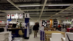 4K shot of people shopping their furniture inside Ikea Stock Footage