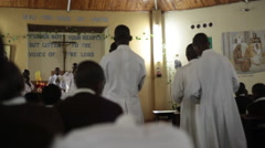 Stock Video Footage of Alter boys in white walk down the aisle in church, Kenya, Africa