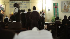 Stock Video Footage of Boarding school boys go to receive blessing, mass in church, Kenya, Africa
