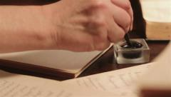Man Writes At The Table. Dolly Shot Stock Footage