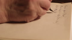 Adult Man Writes At The Table - stock footage