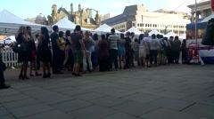 People  queue in birmingham victoria square Stock Footage