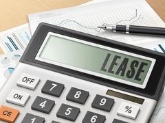 calculator with the word lease - stock illustration