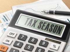 Stock Illustration of calculator with the word tax season