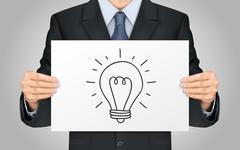 businessman holding lighting bulb poster - stock illustration