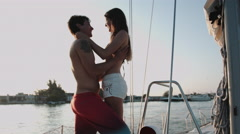 Couple enjoying in sailboat Stock Footage