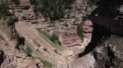 Canyon Bletterbach - Rock beddings and people walking in the valley of stones Stock Footage
