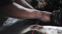 Dirty hands fixing car engine, garage mechanic, Nairobi, Kenya, Africa Stock Footage