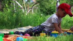 Little boy playing with toys at a garden. dolly shot - stock footage