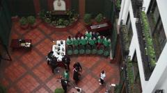 Kenyan sports team taking official photo in hotel, long shot, Nairobi Stock Footage