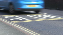 Slow Road Markings on Tarmac Road in England Stock Footage