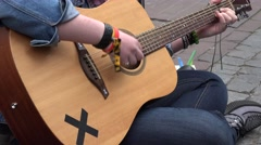 Woman hands play with acoustic guitar musical instrument in street. 4K - stock footage